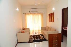 A seating area at OYO 230 Tulasi Mahal