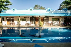 The swimming pool at or near Floral Villarosa