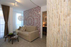 A seating area at Apartments & Rooms Mareta Exclusive