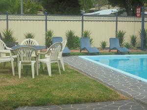 The swimming pool at or near Riverbank Park MOTEL