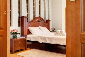 A bed or beds in a room at Orbita Hotel