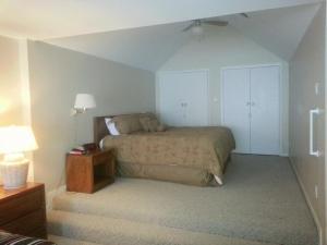 Ein Bett oder Betten in einem Zimmer der Unterkunft Ruidoso Downs Condos at Champion's Run, a VRI resort