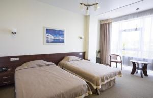 Кровать или кровати в номере Отель AVANT