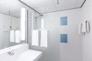 Ein Badezimmer in der Unterkunft Novotel Eindhoven