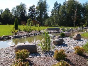 A garden outside Atpūtas komplekss Burtakas