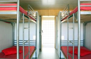 A bunk bed or bunk beds in a room at HI Ponte de Lima - Pousada de Juventude