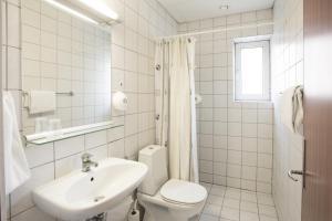 A bathroom at Milling Hotel Ansgar