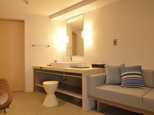 A bathroom at Atami Seaside Spa & Resort