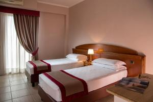 A bed or beds in a room at Marini Park Hotel