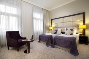 מיטה או מיטות בחדר ב-מלון כשר קינג דייויד פראג