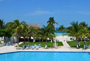 The swimming pool at or near Beachscape Kin Ha Villas & Suites
