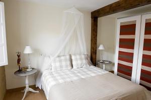 Cama o camas de una habitación en Apartamentos Turísticos Los Zapatos Morados