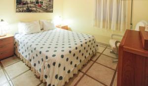 Cama o camas de una habitación en Esmeralda Sevilla