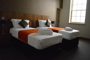 Letto o letti in una camera di The Inn Place