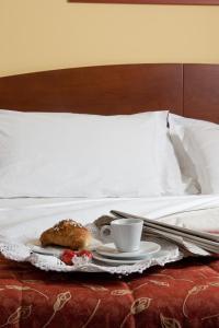 Letto o letti in una camera di Hotel La Cascata