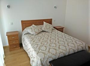 Uma cama ou camas num quarto em Agroturismo A Fidalga