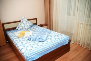 Кровать или кровати в номере Апартаменты Уютный Дом