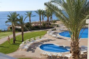 Uitzicht op het zwembad bij Stella Di Mare Beach Hotel & Spa of in de buurt
