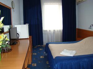 Кровать или кровати в номере Гостиница Волгодонск