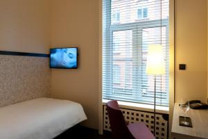 Een TV en/of entertainmentcenter bij Hotel Topas