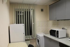A kitchen or kitchenette at Hostel Sakvoiaj