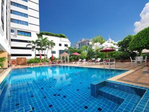 The swimming pool at or near Grand President Bangkok