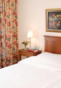 Кровать или кровати в номере Hotel Deutsches Theater Stadtzentrum