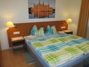 Ein Bett oder Betten in einem Zimmer der Unterkunft Pension Weinhaus Unger