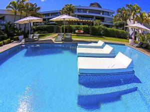 The swimming pool at or near Leora Beachfront by Horizon Holidays