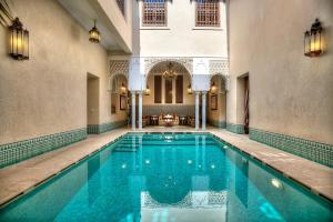 The swimming pool at or near Riad Kniza