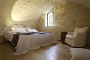 A bed or beds in a room at Corte San Pietro