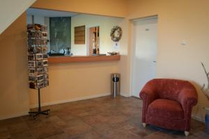 Lobby/Rezeption in der Unterkunft Hotel Bos en Duinzicht