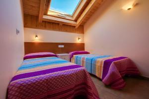 Cama o camas de una habitación en Hostal Parque Natural