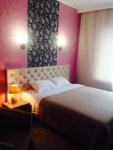 Кровать или кровати в номере Hotel POSHALE