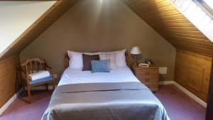 A bed or beds in a room at Cove Bay Hotel