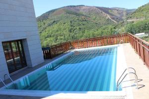 The swimming pool at or near Parador de Villafranca del Bierzo