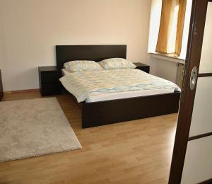 Ein Bett oder Betten in einem Zimmer der Unterkunft Apartments Tronicek