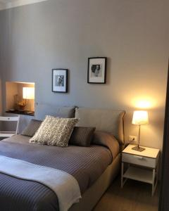 A bed or beds in a room at Il Portico