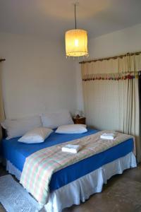 Cama ou camas em um quarto em Pousada Asa do Vento