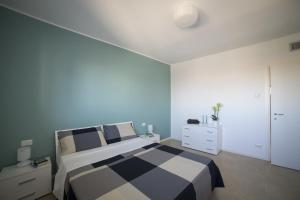 A bed or beds in a room at Residence Milano Bicocca