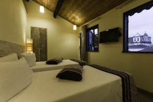 A bed or beds in a room at Bahiacafé Hotel