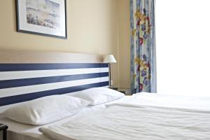 Кровать или кровати в номере Aparthotel Zingst