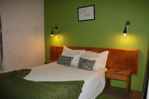 Ein Bett oder Betten in einem Zimmer der Unterkunft Hospedaria Verdemar