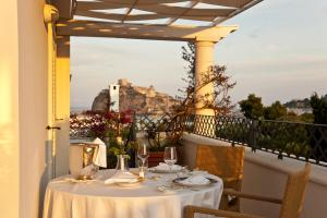 A restaurant or other place to eat at Excelsior Belvedere Hotel & Spa