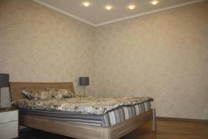 Кровать или кровати в номере Апартаменты «Войкова 23»