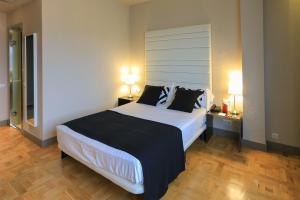 Cama o camas de una habitación en Sercotel Leyre