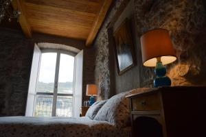 A bed or beds in a room at La Terrazza di Vico Olivi B&B