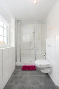 Ein Badezimmer in der Unterkunft Pension Burggaststätte Heyken