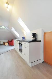 Küche/Küchenzeile in der Unterkunft Pension Burggaststätte Heyken