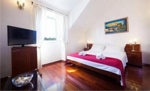 Łóżko lub łóżka w pokoju w obiekcie Villa Slika